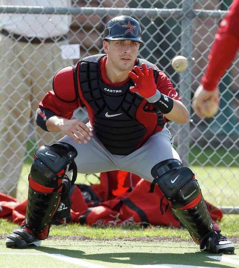 Jason Castro se puso a punto durante el campamento de primavera de los Astros en el Osceola County Stadium de Kissimmee, Florida. Photo: Karen Warren / © 2012  Houston Chronicle