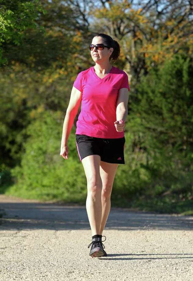Renee Graves walks at Comanche Lookout Park. She lost more than 50 pounds last year and has kept it off by walking. Photo: TOM REEL, San Antonio Express-News / San Antonio Express-News