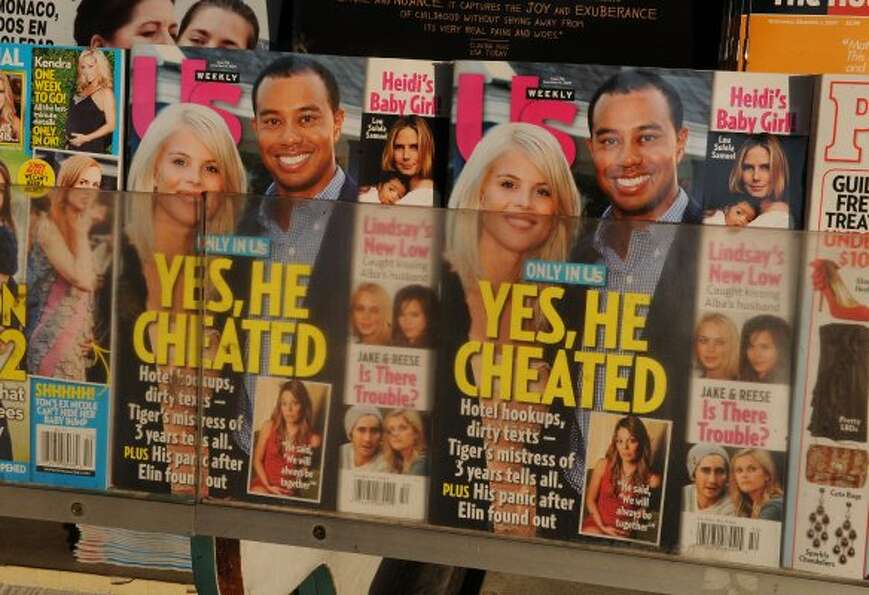 Copies of Us Weekly magazine featuring the story on Tiger Woods and the interview with alleged mistr