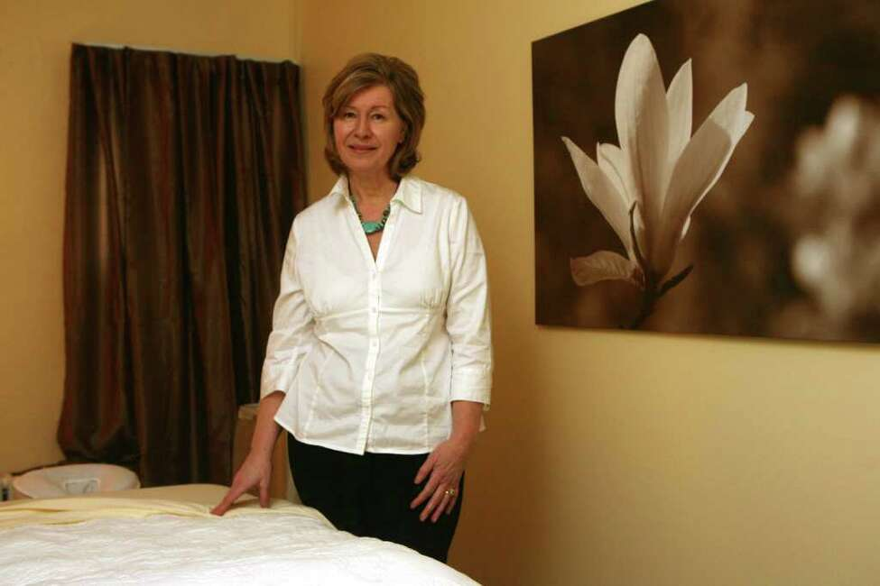 Wellness coach and founder of Wellness Wisdom Suzanne Antal-Proietti stands in her Norwalk, Conn. office which offers consultation and reading rooms and two massage rooms on Monday, March 26, 2012.