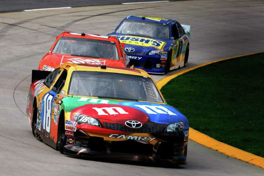 Kyle Busch eads Joey Logano and Bobby Labonte during practice for Sunday's Sprint Cup race in Martinsville, Va. Qualifying is scheduled for today. Photo: AP