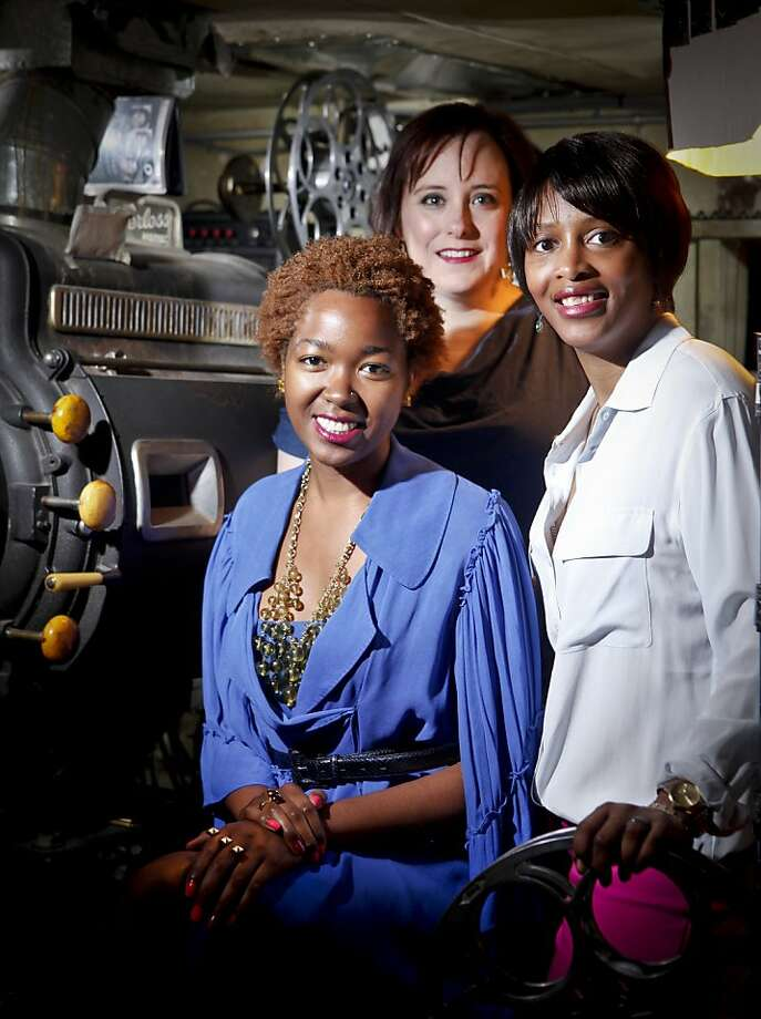 Fashion Film Festival founders Adelle McElveen, front, Kimara Mitchell Stokes, right, and Annie Wilson are seen in the projection booth at the Roxie Theater on Monday, March 19, 2012 in San Francisco, Calif. Photo: Russell Yip, The Chronicle