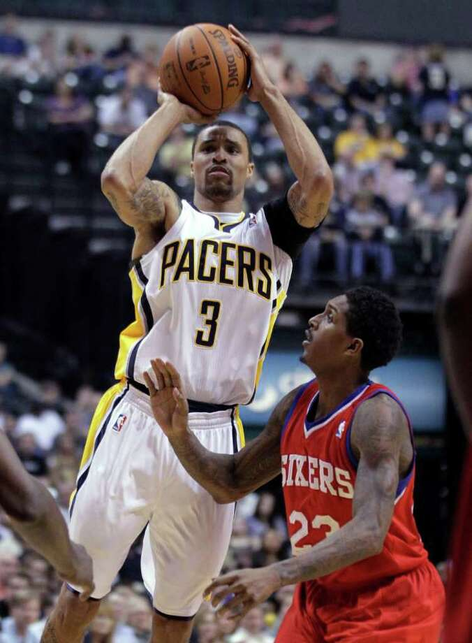 Like he did as a Spur, George Hill (left) is succeeding as backup combo guard and defensive stopper with the Pacers. Photo: AP