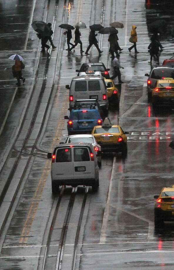 Pedestrians crossing on California St. in San Francisco Calif., on Tuesday, March 13, 2012. Photo: Liz Hafalia, The Chronicle