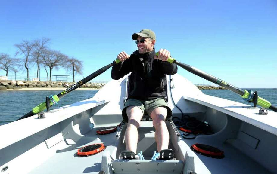 John Bauby, of Easton, trains for a solo row boat trip across the Atlantic, planned for 2013, Friday, Mar. 30, 2012 off West Beach in Stamford, Conn. Photo: Autumn Driscoll / Connecticut Post