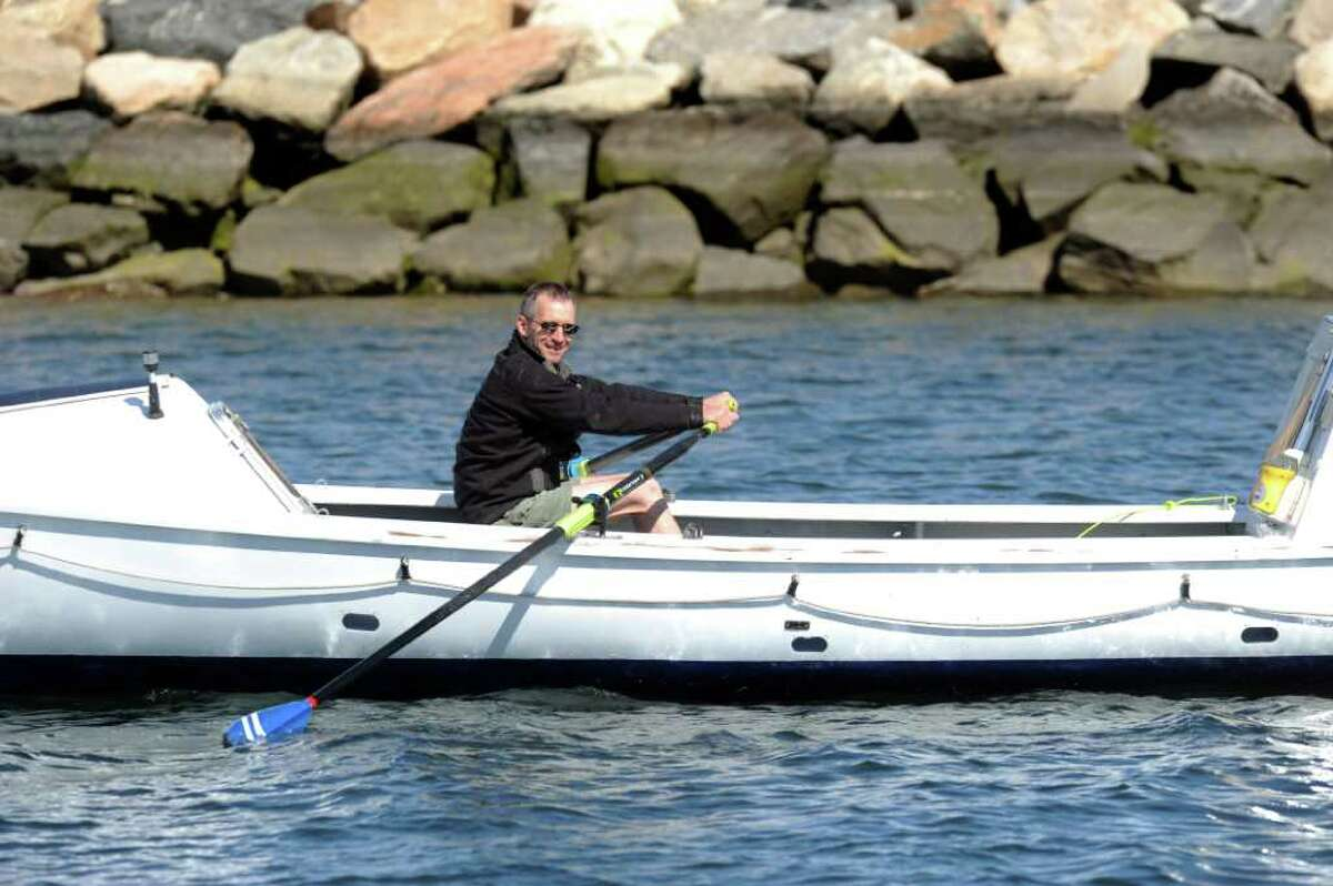 John Bauby, of Easton, trains for a solo row boat trip across the Atlantic, planned for 2013, Friday, Mar. 30, 2012 off West Beach in Stamford, Conn.