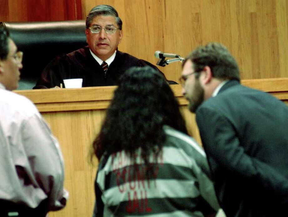 Angela Camacho accompanied with her attorneys stands before Judge Benjamin Euresti during a plea bargain Thursday June 30, 2005 at the Camreron County Couthouse, in Brownsville Texas.  Comacho plead guilty for murdering her three children in March 2003.  Photo by Theresa Najera Photo: THERESA NAJERA, AP / BROWNSVILLE HERALD