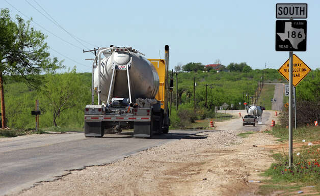 South Texas county roads are taking a beating from oil field related traffic in the Eagle Ford Shale. Photo: JERRY LARA, San Antonio Express-News / SAN ANTONIO EXPRESS-NEWS