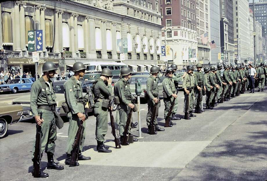 National guardsmen line street during the 1968 Democratic National Convention, Chicago (111). 1968. Photography by Charles Roland.   68 Project at the Oakland Museum of California Photo: Charles Roland.