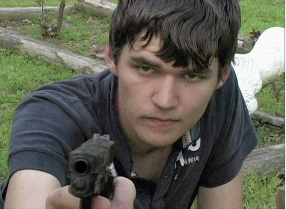 """Photo of Trey Sesler posted to his Facebook page on March 20, 2010 with caption """" Me with a prop gun during a movie shoot. bang"""" Photo: Unknown / handout web"""
