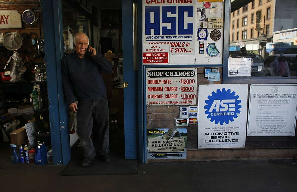 Owner of Allied Engine & Auto Repair, Paul Grech talks with a client on the phone in his shop on Ellis Street in San Francisco, Calif.