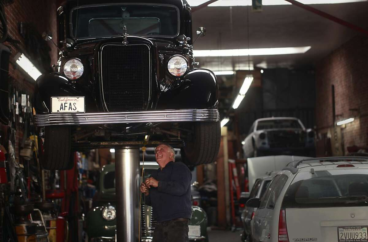 Owner of Allied Engine & Auto Repair, Paul Grech replaces a leaky oil line on his 1936 Ford pickup in San Francisco, Calif.