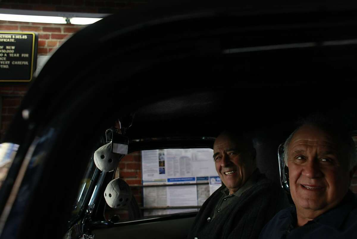 Owner of Allied Engine & Auto Repair, Paul Grech (rt) with his father Frank Grech sits in Paul's 1936 Ford pickup in San Francisco, Calif.