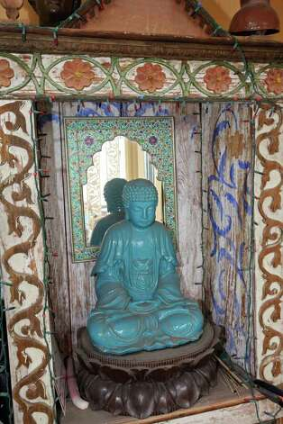 A statue of Buddha is in the enclosed porch. Photo: DANNY WARNER