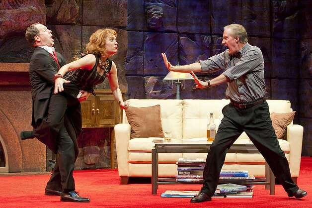 "Alan (Benjamin Evett, left) tries to hold back Veronica (Amy Resnick) from attacking her husband Michael (Bob Sorenson) in San Jose Rep's production of Yasmina Reza's ""God of Carnage"" Photo: Tim Fuller"