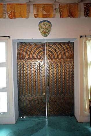 The striking front doors, clad in metal, came from Isaac Maxwell Metal. Photo: DANNY WARNER