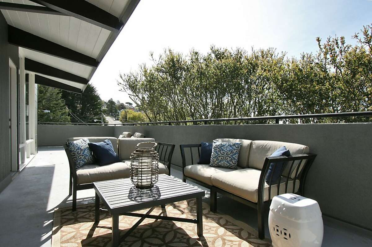 Mature trees for privacy surround small outdoor terraces and decks that can be accessed throughout the home.