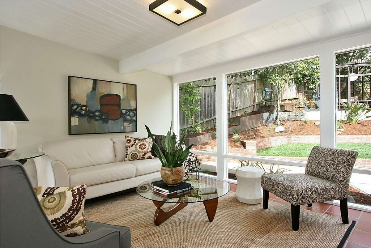 A wall of windows in the family room provides a view of the immaculate natural landscaping in the backyard.