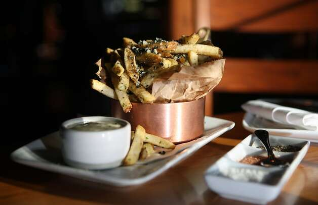 The truffled french fries are among the specialties at Willi's Wine Bar in Santa Rosa. Chef John Stroup creates a small-plate menu that hops continents: foie gras poppers; filet mignon sliders; and Moroccan lamb chops. Photo: Lance Iversen, San Francisco Chronicle