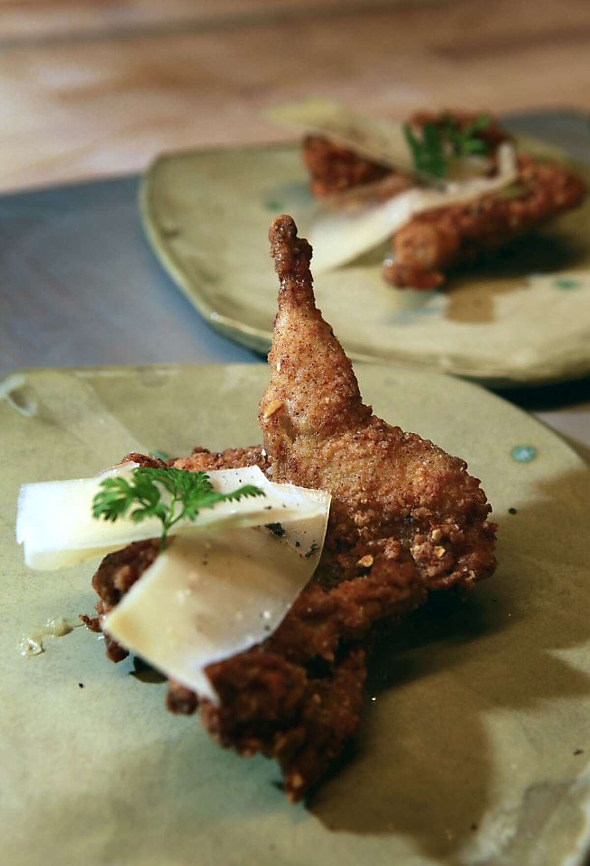 Stuart Brioza, chef/owner of the State Bird Provisions restaurant on Fillmore Street, plates his signature quail dish in San Francisco, Ca., on Wednesday Jan. 4 2012.