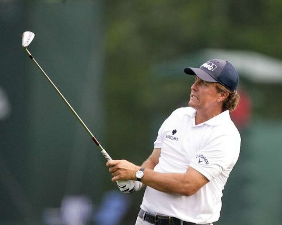 Phil Mickelson cringes at a shot on the fairway on the 11th hole during the first round. (Nick de la Torre / Houston Chronicle)