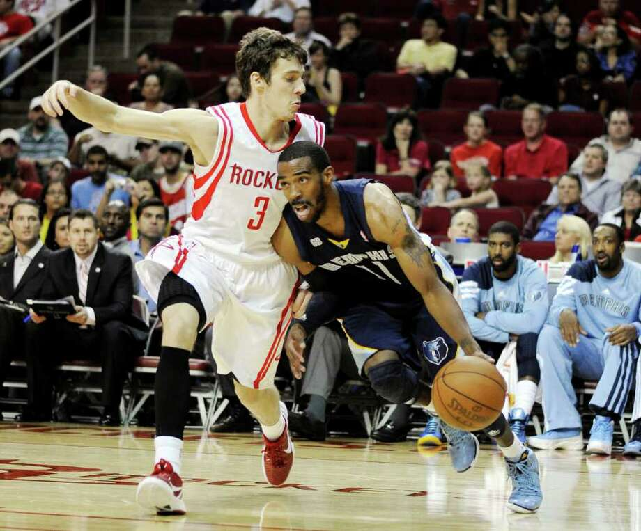 Memphis Grizzlies' Mike Conley (11) pushes past Houston Rockets' Goran Dragic (3) in the first half of an NBA basketball game, Friday, March 30, 2012, in Houston. (AP Photo/Pat Sullivan) Photo: Pat Sullivan, Associated Press / AP