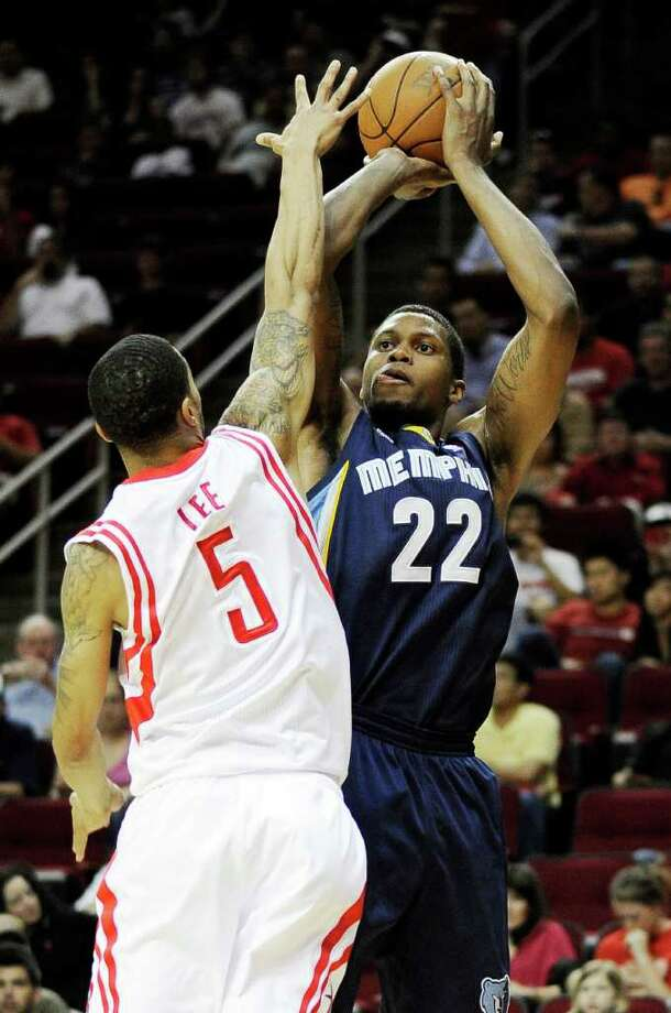 Memphis Grizzlies' Rudy Gay (22) shoots over Houston Rockets' Courtney Lee (5) in the first half of an NBA basketball game, Friday, March 30, 2012, in Houston. (AP Photo/Pat Sullivan) Photo: Pat Sullivan, Associated Press / AP