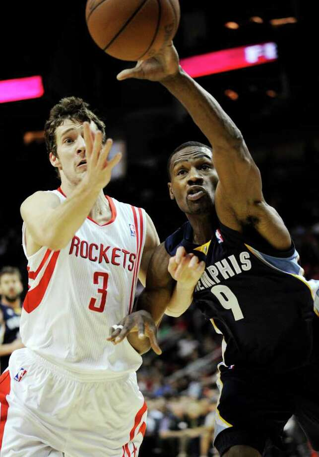 Houston Rockets' Goran Dragic (3) and Memphis Grizzlies' Tony Allen (9) go after a loose ball in the first half of an NBA basketball game, Friday, March 30, 2012, in Houston. (AP Photo/Pat Sullivan) Photo: Pat Sullivan, Associated Press / AP
