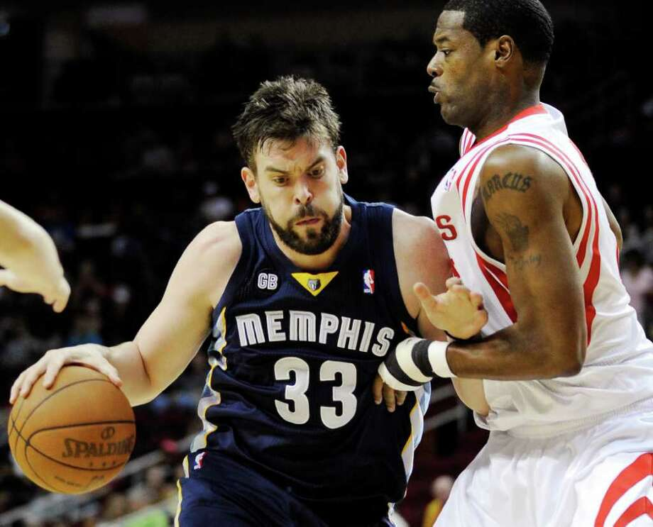 Memphis Grizzlies' Marc Gasol (33) leans into Houston Rockets' Marcus Camby, right, in the first half of an NBA basketball game, Friday, March 30, 2012, in Houston. (AP Photo/Pat Sullivan) Photo: Pat Sullivan, Associated Press / AP