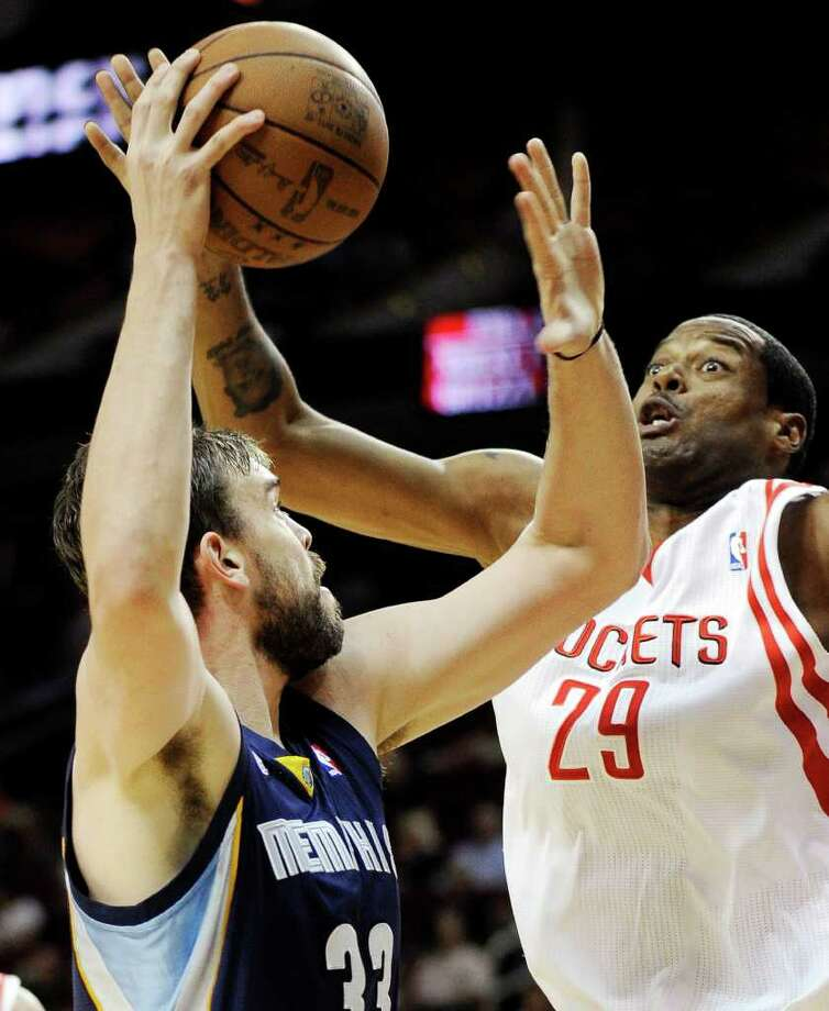 Memphis Grizzlies' Marc Gasol (33) shoots against Houston Rockets' Marcus Camby (29) in the first half of an NBA basketball game, Friday, March 30, 2012, in Houston. (AP Photo/Pat Sullivan) Photo: Pat Sullivan, Associated Press / AP