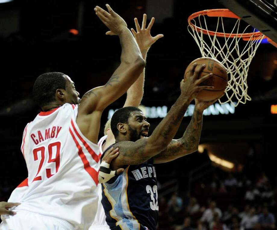 Memphis Grizzlies' O.J. Mayo (32) goes to the basket in front of Houston Rockets' Marcus Camby (29) in the first half of an NBA basketball game on Friday, March 30, 2012, in Houston. (AP Photo/Pat Sullivan) Photo: Pat Sullivan, Associated Press / AP