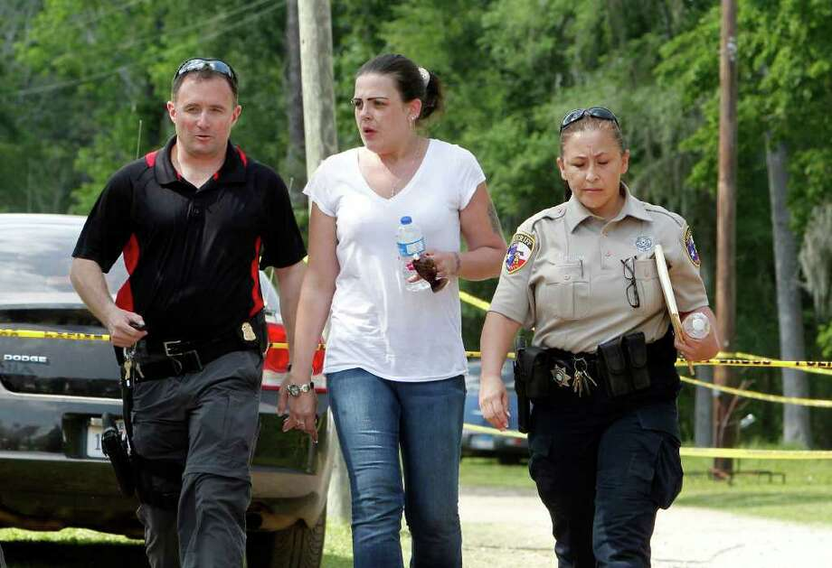 April Davis, the mother of 2½-year-old Devon Davis, is seen earlier this week with law enforcement officers as they searched along with volunteers for her son. The child went missing on Tuesday in Cleveland. Photo: James Nielsen / © 2012 Houston Chronicle
