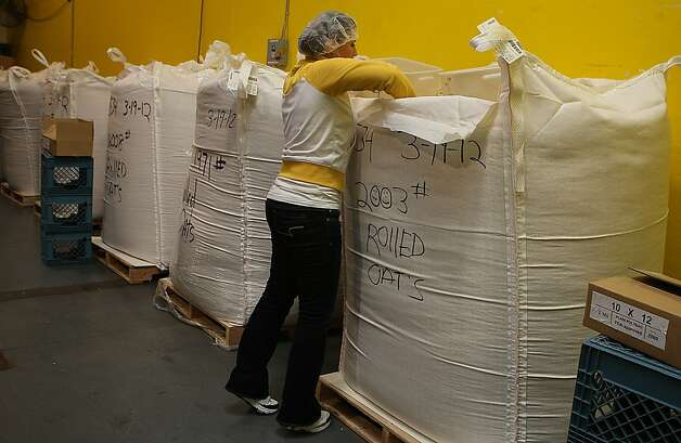 Ariana Casillas from San Francisco getting oatmeal for packaging at the San Francisco Food Bank  in San Francisco, Calif., while volunteering on Tuesday, March 20, 2012. Photo: Liz Hafalia, The Chronicle