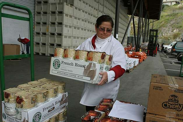 Ana Perez from Salvation Army Harbor Lights loading food supplies from the Food Bank in San Francisco, Calif., on Tuesday, March 20, 2012.   The San Francisco Food Bank distributes donated food to low-income families, individuals and more than 400 local nonprofit agencies. Photo: Liz Hafalia, The Chronicle