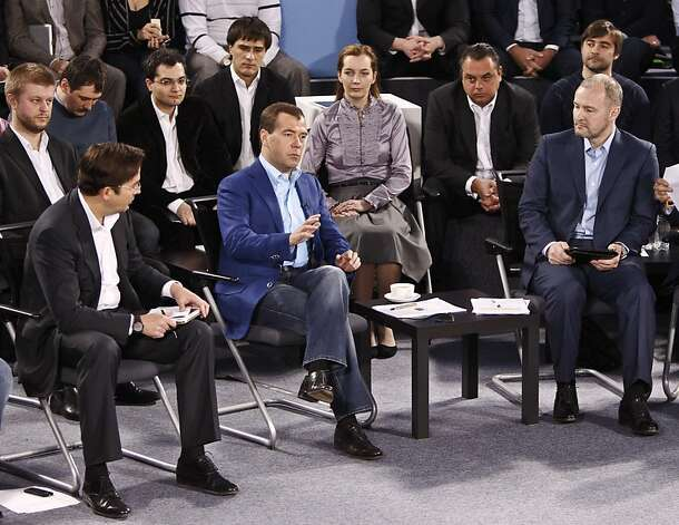 Russian President Dmitry Medvedev, second left, attends a meeting with members of the Open Government project at the Skolkovo school of management outside Moscow, Wednesday, March 14, 2012. (AP Photo/Anton Golubev, Pool) Photo: Anton Golubev, Associated Press
