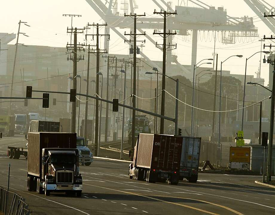 In this file photo, trucks move containers in and out of the Port of Oakland. Photo: John Storey, Special To The Chronicle