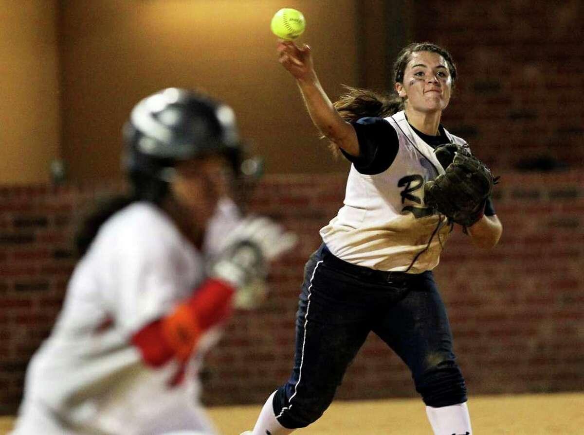 Ranger third baseman Alexandra Alonso picks off Angie Villarreal on a bunt as Canyon host Smithson Valley in softball on March 30, 2012. Tom Reel/ San Antonio Express-News
