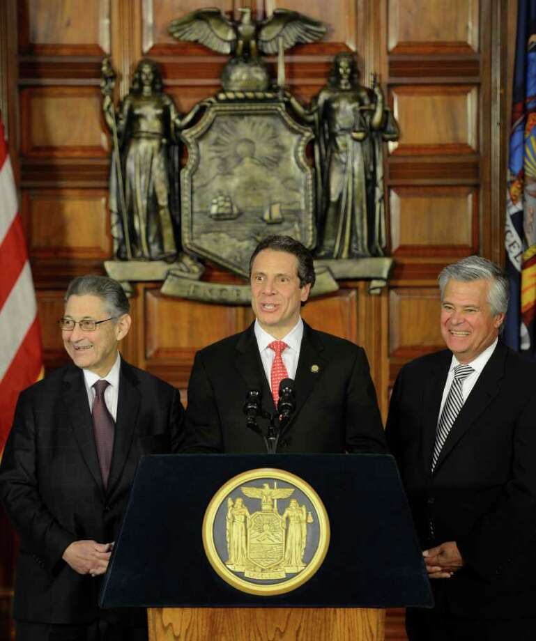 Everyone is all smiles as Assembly Speaker Shelly Silver, left joins Governor Andrew Cuomo, center and Senate Majority Leader Dean Skelos, right in celebrating an on-time budget during a press conference at the State Capitol in Albany, N.Y. March 30, 2012.     (Skip Dickstein / Times Union) Photo: SKIP DICKSTEIN