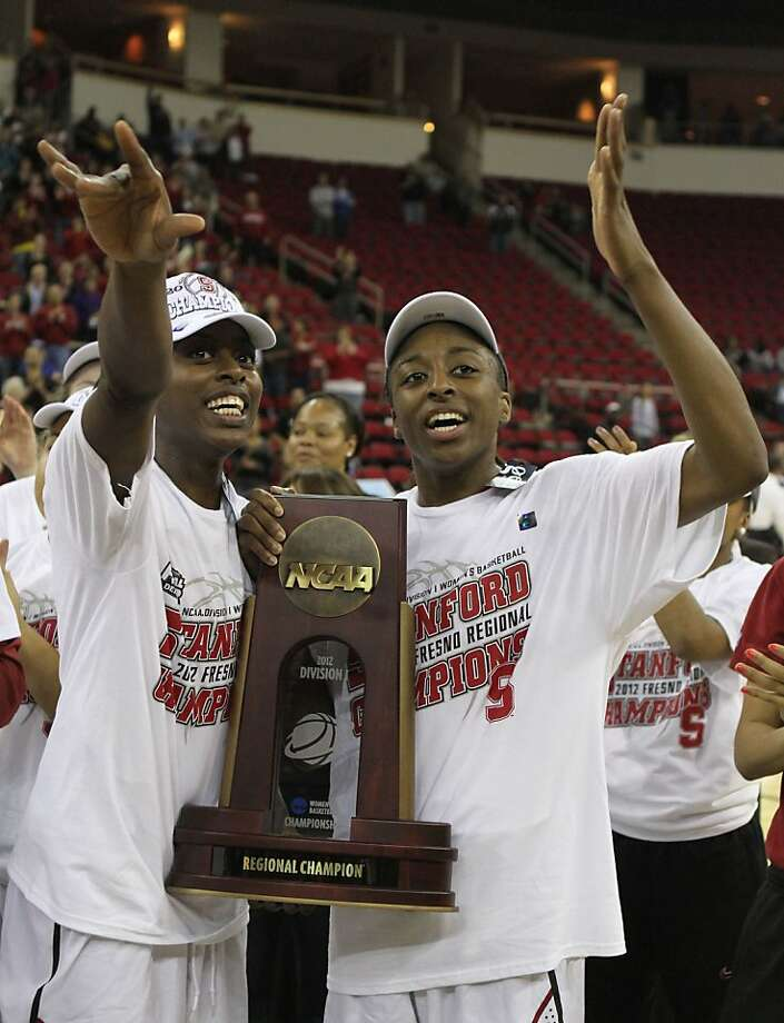 Stanford's Chiney, left, and Nnemkdadi Ogwumike, wave to the crowd as they hold the trophy Stanford received after defeating Duke in the  NCAA women's tournament regional final college basketball game,  Monday, March 26, 2012, in Fresno, Calif.  Stanford beat Duke 81-69  and is heading to the Final Four in Denver.(AP Photo/Rich Pedroncelli) Photo: Rich Pedroncelli, Associated Press