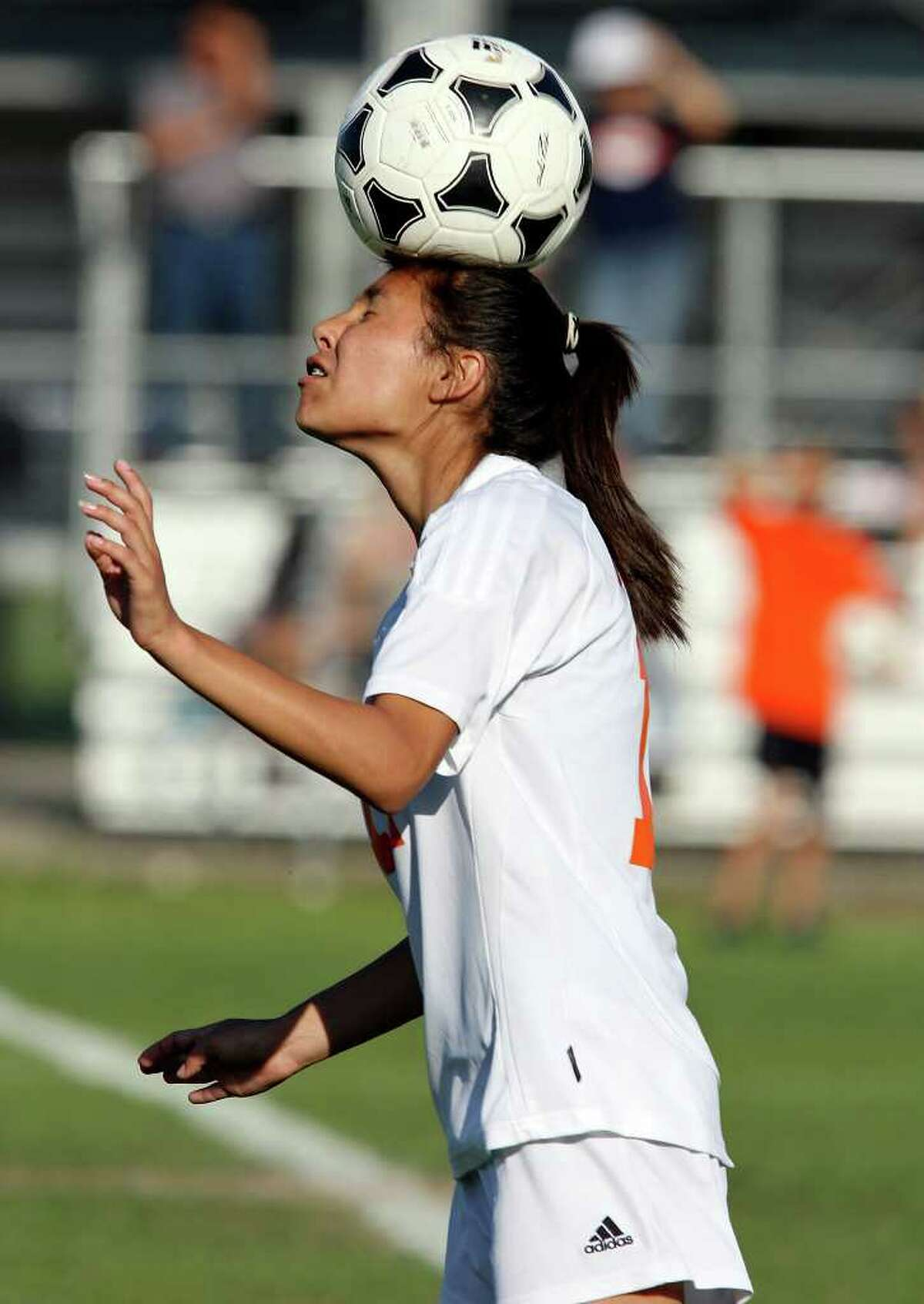 Burbank's Leticia Gomez heads the ball during first half action against Brennan in their Class 4A first round playoff game Friday March 30, 2012 at SAISD Sports Complex.