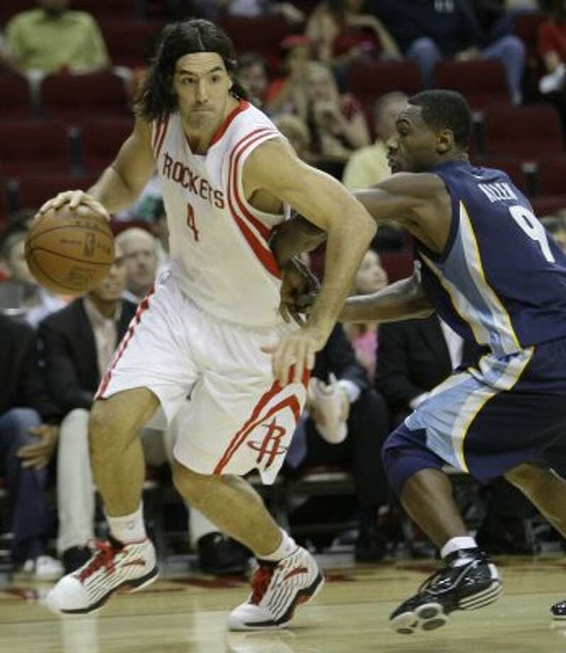 Rockets forward Luis Scola takes the ball around Grizzlies guard Tony Allen during the first quarter. (Melissa Phillip / Chronicle)