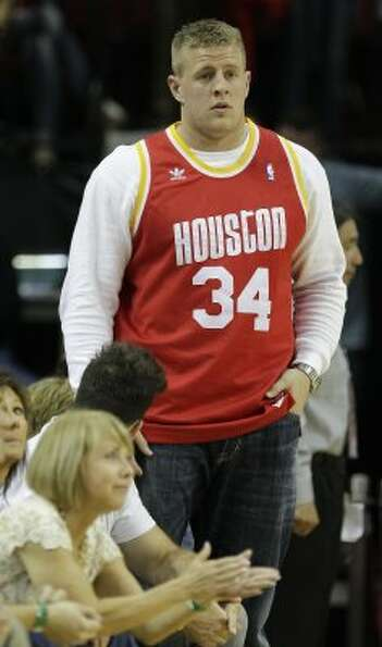 Texans player J. J. Watt wears a Hakeem Olajuwon jersey while attending the game. (Melissa Phillip /
