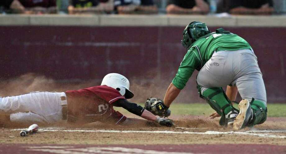 Cole Williams of Magnolia is tagged out at home by Brenham's Ryan Newman during Friday's game. Magnolia handed Brenham its first loss in District 17-4A. Photo: Eric Christian Smith