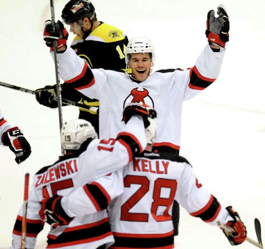 Devil's Eric Gelinas (24), center, and Steve Zalewski (15), left, celebrate Dan Kelly's second-period goal against the Providence Bruins on Friday, March 30, 2012, at Times Union Center in Albany, N.Y. (Cindy Schultz / Times Union) Photo: Cindy Schultz / 00016873C