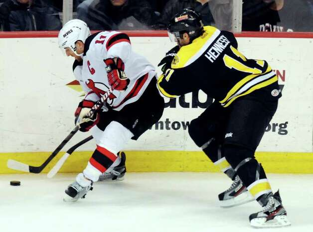 Devils' Stephen Gionta (11), left, controls the puck as Providence Bruins' Josh Hennessy (11) defends during their hockey game on Friday, March 30, 2012, at Times Union Center in Albany, N.Y. (Cindy Schultz / Times Union) Photo: Cindy Schultz / 00016873C