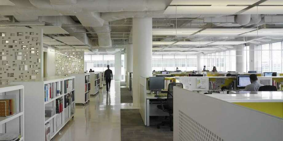 Corporate architecture firm PDR s designed its workplace at Two Houston Center with energy saving features in mind. The space has earned the LEED Commercial Interior Design and Construction Platinum designation. Photo: Courtesy Photo