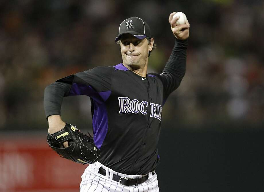 Colorado Rockies starting pitcher Jamie Moyer throws to the San Francisco Giants during the second inning of a spring training baseball game Thursday, March 22, 2012 in Scottsdale, Ariz. Photo: Marcio Jose Sanchez, Associated Press