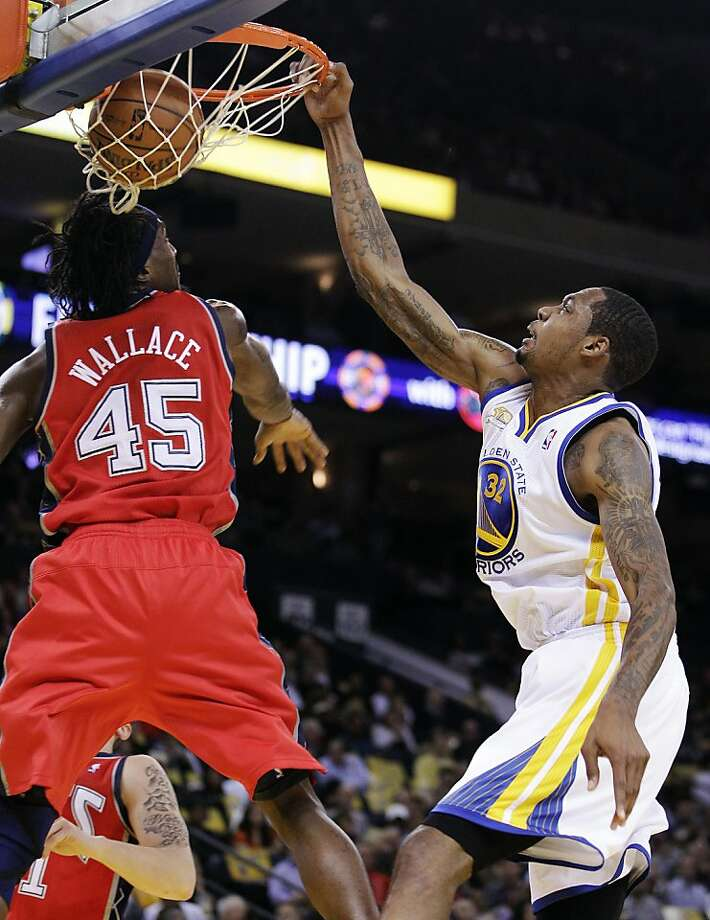 Golden State Warriors' Mickell Gladness, right, dunks over New Jersey Nets' Gerald Wallace (45) during the first half of an NBA basketball game, Friday, March 30, 2012, in Oakland, Calif. Photo: Ben Margot, Associated Press