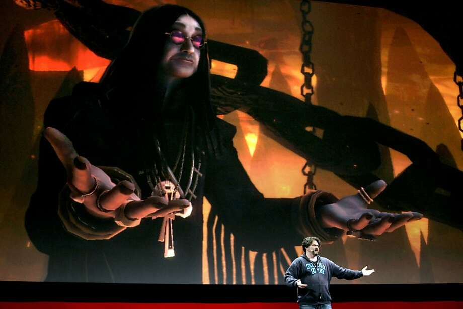An animated Ozzy Ozbourne character from the Electronic Arts Inc. game Brutal Legend appears on screen as Tim Schafer, president of Double Fine Production, speaks during an Electronic Arts news conference prior to the start of the Electronic Entertainment Expo (E3), in Los Angeles, California, U.S., on Monday, June 1, 2009. The video-game industry's biggest sellers, including Sony Corp., Microsoft Corp. and Nintendo Co., are looking to this week's expanded E3 Expo to return some excitement to a slumping industry. Photographer: Jonathan Alcorn/Bloomberg News An animated Ozzy Ozbourne character from the Electronic Arts Inc. game Brutal Legend appears on screen as Tim Schafer, president of Double Fine Production, speaks during an Electronic Arts news conference prior to the start of the Electronic Entertainment Expo (E3), in Los Angeles, California, U.S., on Monday, June 1, 2009. The video-game industry's biggest sellers, including Sony Corp., Microsoft Corp. and Nintendo Co., are looking to this week's expanded E3 Expo to return some excitement to a slumping industry. Photographer: Jonathan Alcorn/Bloomberg News Photo: Jonathan Alcorn, Bloomberg News