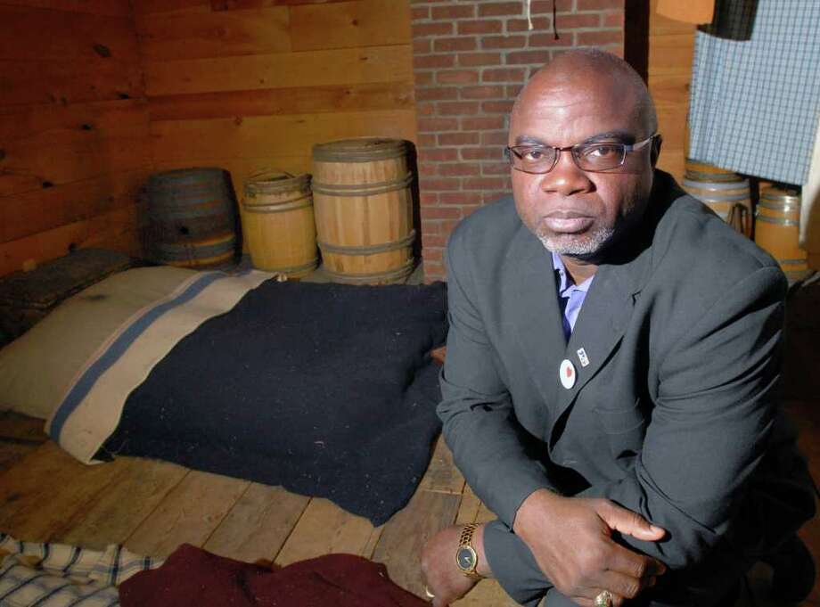 South Carolina native Joseph McGill Jr. in the attic of the Bush-Holley House in Cos Cob, Friday, March 30, 2012. McGill, a descendant of slaves, spent the night in the attic, which Greenwich Historical Society officials believe to be the slave quarters during the early 1800s. McGill seeks to preserve slave shelters, bringing attention to the sad and terrible history of slavery in America. Photo: Bob Luckey / Greenwich Time
